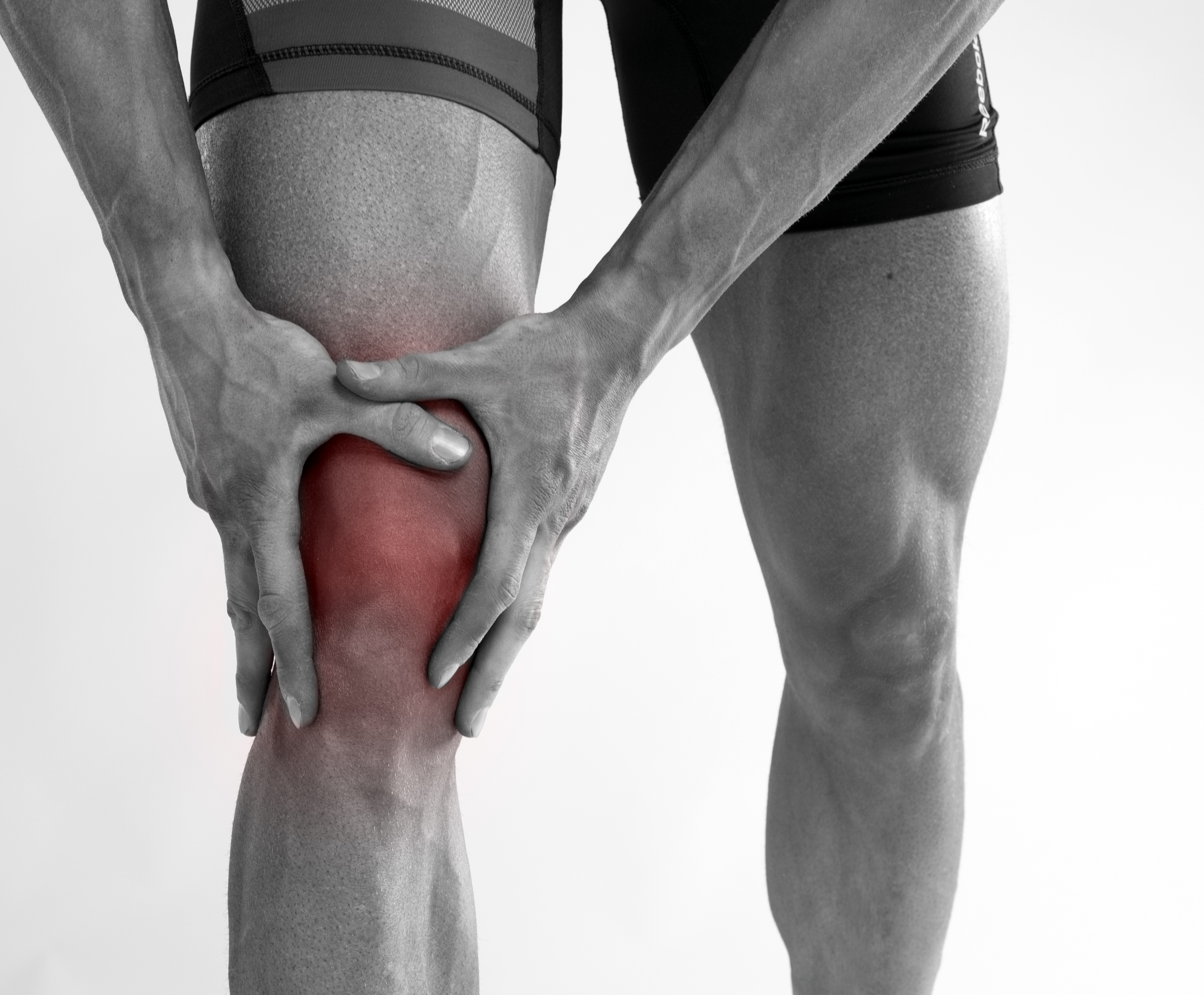 an athlete with chronic pain in his knee